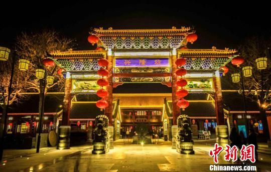 资料图。图为甘肃榆中县兴隆山国际旅游度假区兴隆坊(特色小镇)效果图。 钟欣 摄