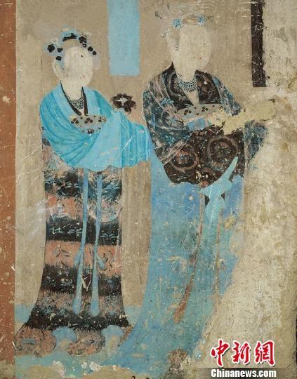 图为莫高窟第12窟晚唐时期《母子襦裙纹样》。敦煌研究院供图