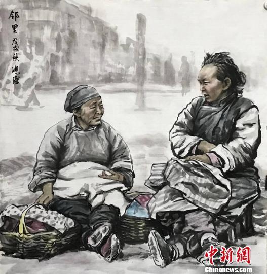 """图为王鸿庆""""记录""""的邻里之间的温情。 魏建军 摄"""