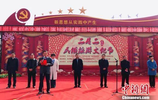 """图为山丹县""""东乐镇二月二民俗注册送体验金无需申请文化节""""现场实况。 艾庆龙 摄"""
