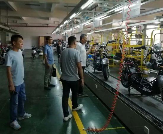 赴无锡韩田电动车有限公司对接新能源电动车加工项目。
