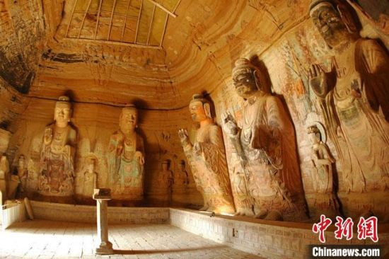 图为位于甘肃庆阳市境内的全国重点文物保护单位北石窟寺165窟北壁。(资料图) 甘肃省文物局供图 摄