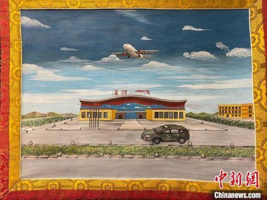 图为描绘夏河县机场的唐卡作品。 宋子昕 摄